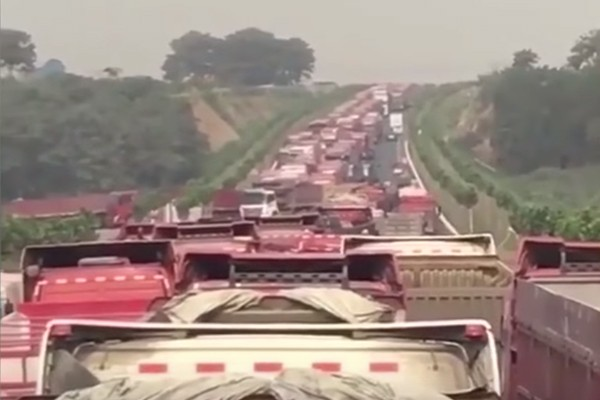 Truckers block road in protest (Screenshot from RFA YouTube video)