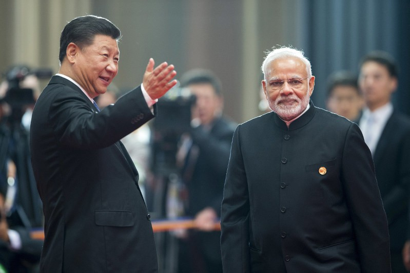 Chinese President Xi Jinping, welcomes Indian Prime Minister Narendra Modi for a meeting at the Shanghai Cooperation Organization
