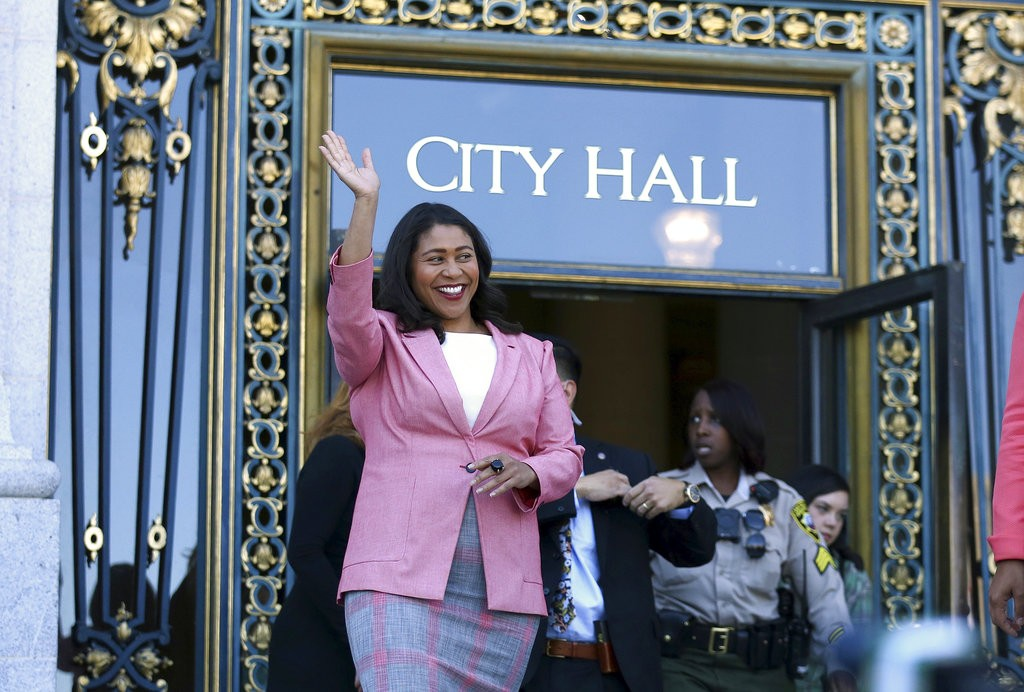London Breed waves before speaking to reporters outside of City Hall in San Francisco, Wednesday, June 13, 2018. Breed was poised to become the first