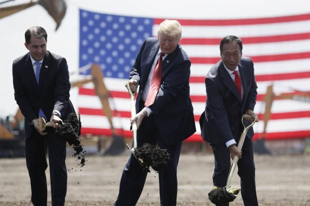 From left to right, Wisconsin Governor Scott Walker, President Donald Trump and Foxconn Chairman Terry Gou at the groundbreaking ceremony for a Foxcon...