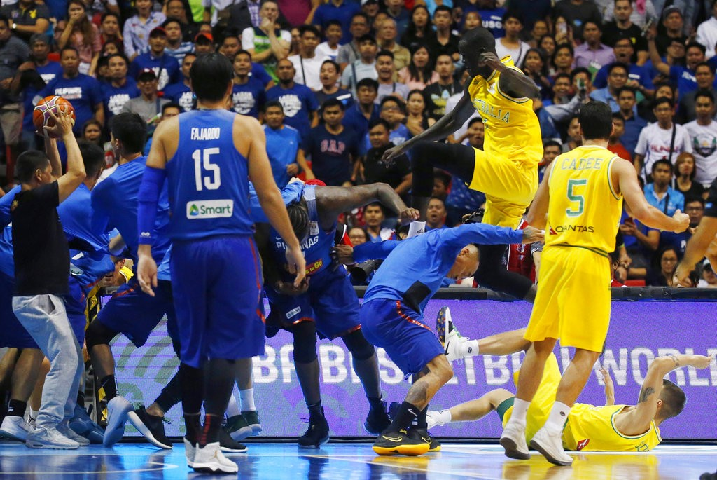 NBA player Thon Maker launching flying kick.
