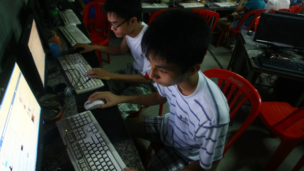 Young Facebook user at an internet cafe in Vietnam