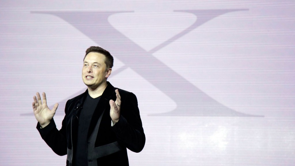 Elon Musk presenting at a SpaceX conference