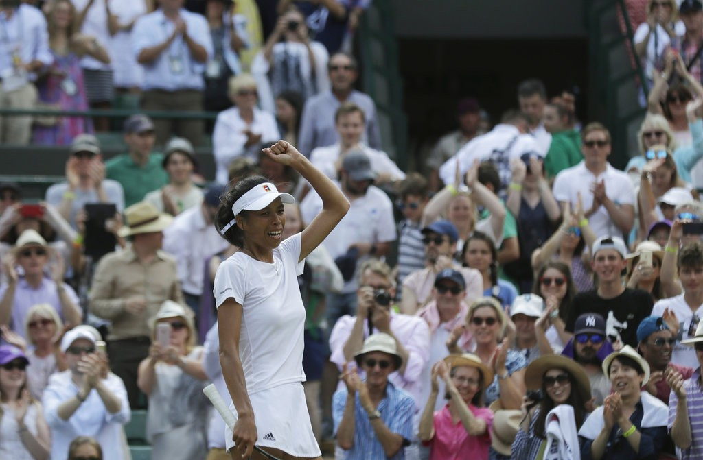 Hsieh celebrates victory at Wimbledon.