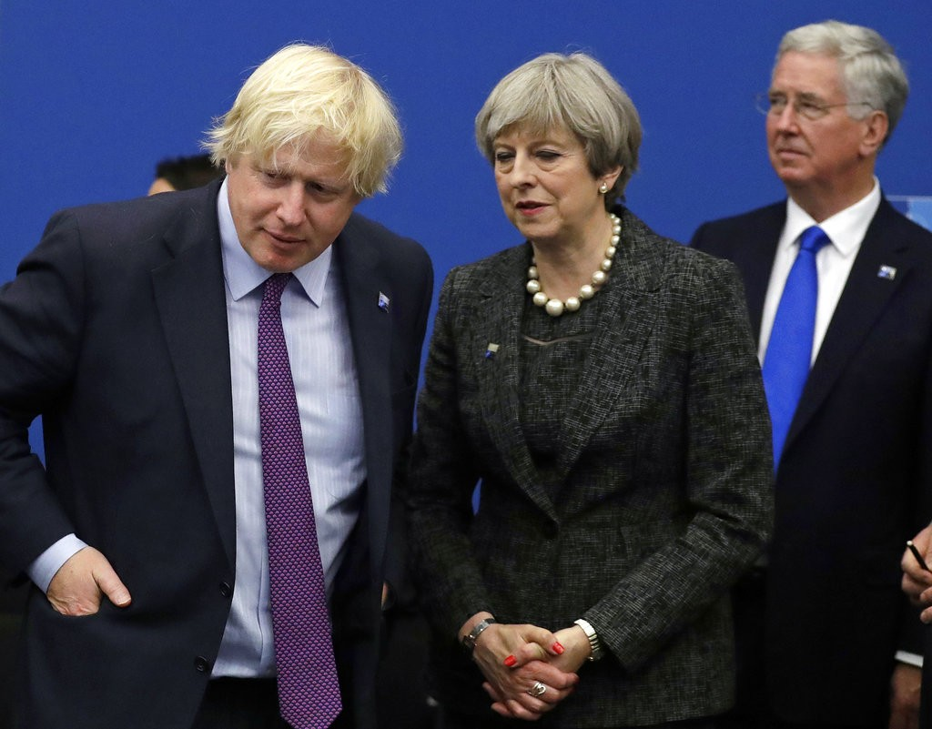 In this file photo dated Thursday, May 25, 2017, British Prime Minister Theresa May talks with British Foreign Minister Boris Johnson (AP)