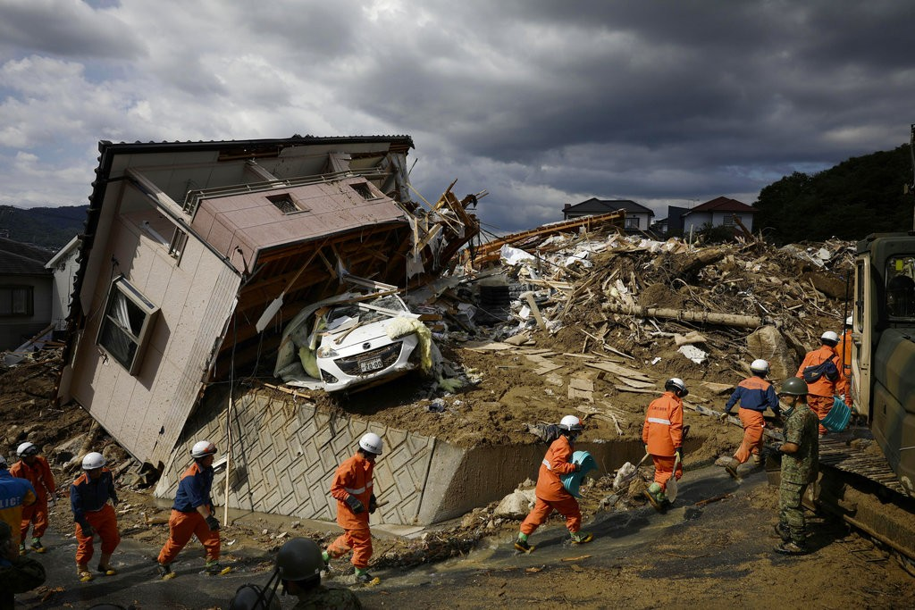 Aftermath of flooding and landslides in Kumano town, Hiroshima prefecture, July 9.