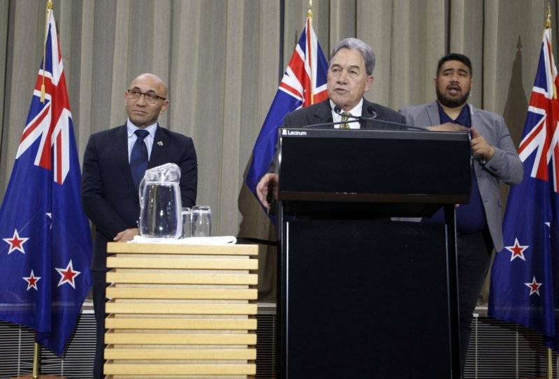 New Zealand PM Winston Peters (center) and Defense Minister Ron Mark (left)  at a Press Conference Monday, July 9