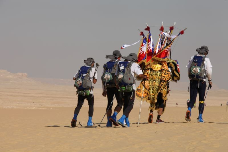 "A photograph of Chio-Tian members participating in a 2011 ultramarathon in the Sahara Desert is featured in the exhibition ""Tradition in Near Future: ..."