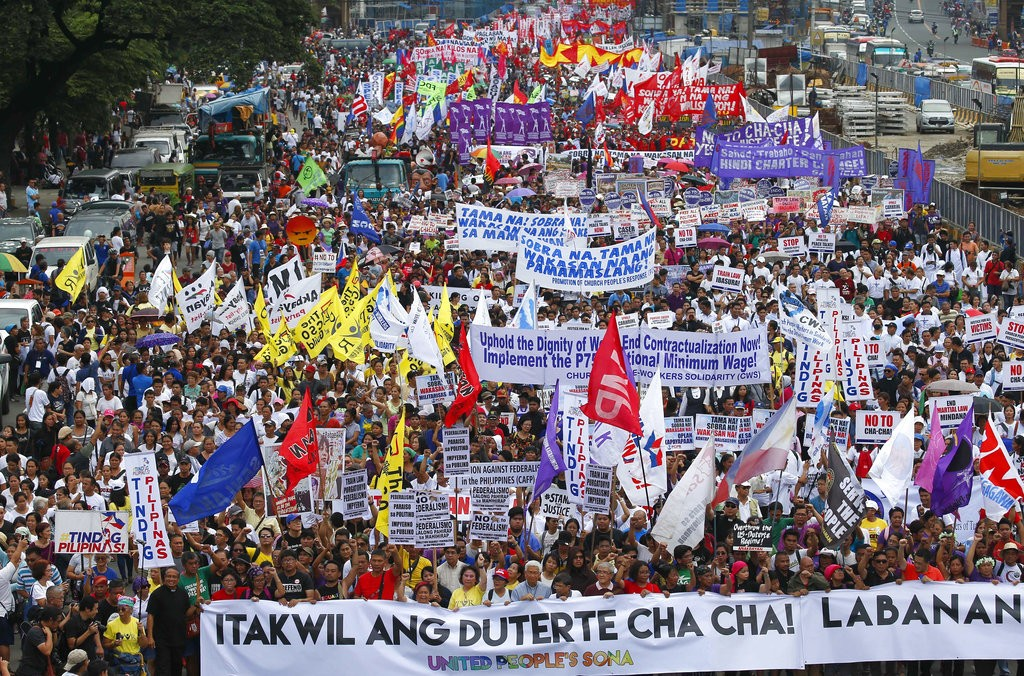 Thousands of protesters march to the Philippine Congress Monday, July 23