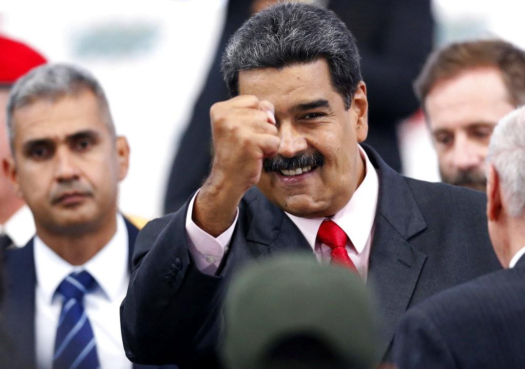 委内瑞拉總統馬杜洛(握拳者)(美聯社)