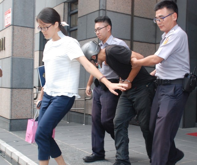 Bouazza being escorted out of police station.