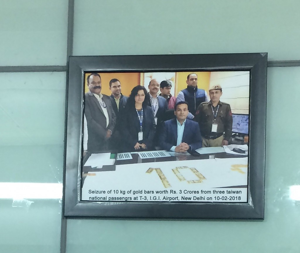 India's airports display pictures of gold smuggling by Taiwanese travelers.