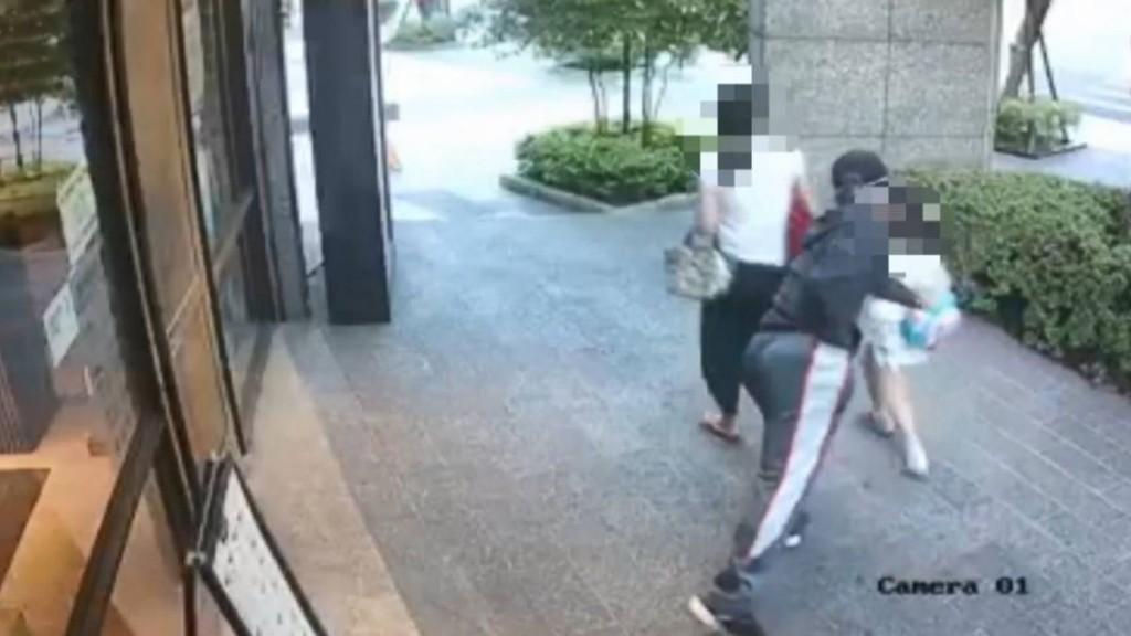 Man lunging towards girl. (Screenshot of Baoliao Commune YouTube video)