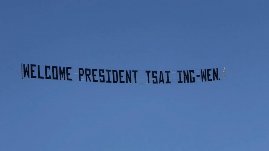 Taiwan supporters fly a welcoming banner Sunday afternoon as President Tsai Ing-wen arrives in L.A.