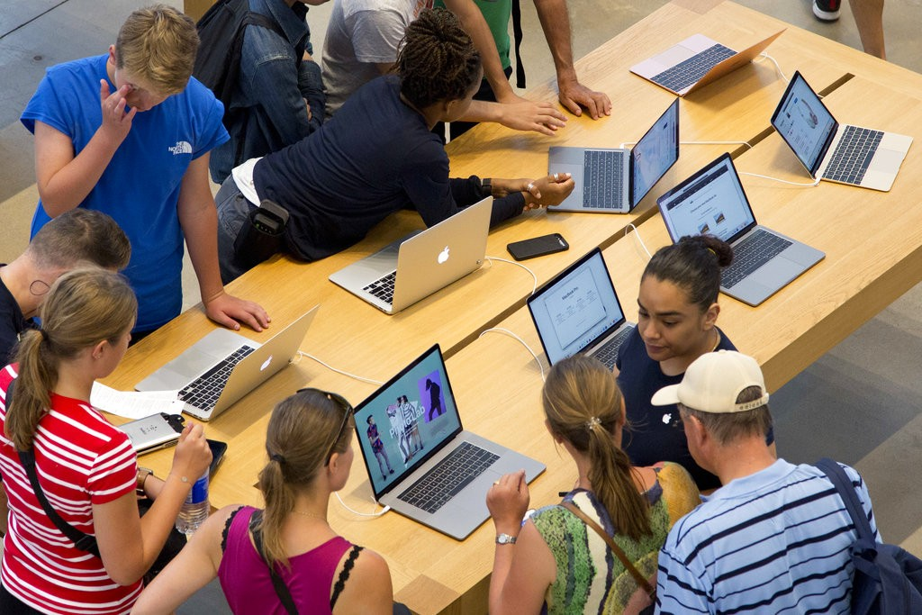Consumers at an Apple store.