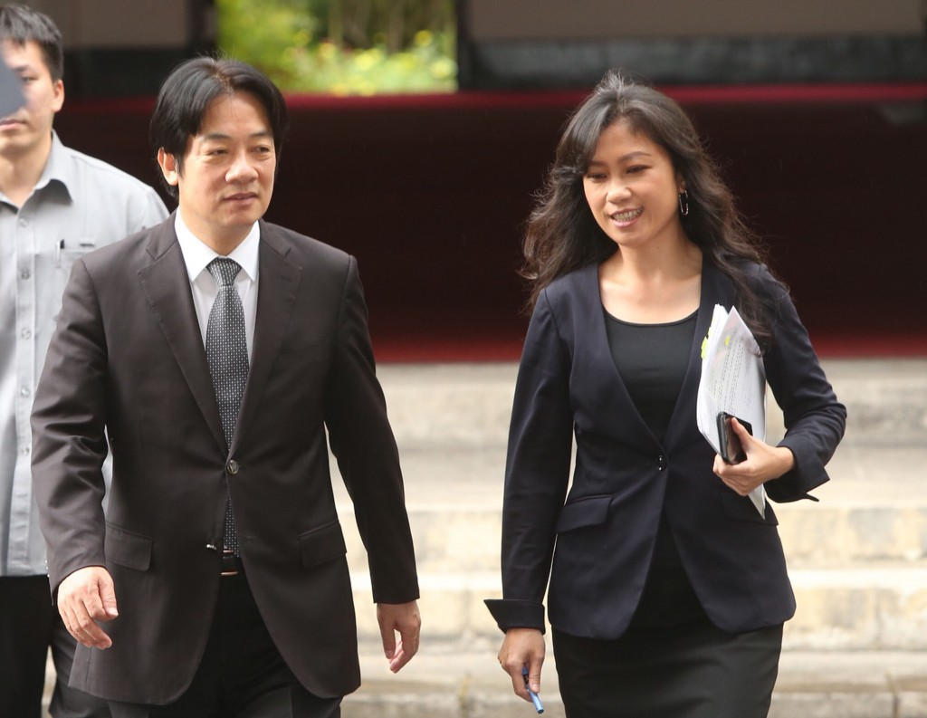 Premier Lai (foreground, left) with Cabinet spokesperson Kolas Yotaka (right) on their way to explain the budget.