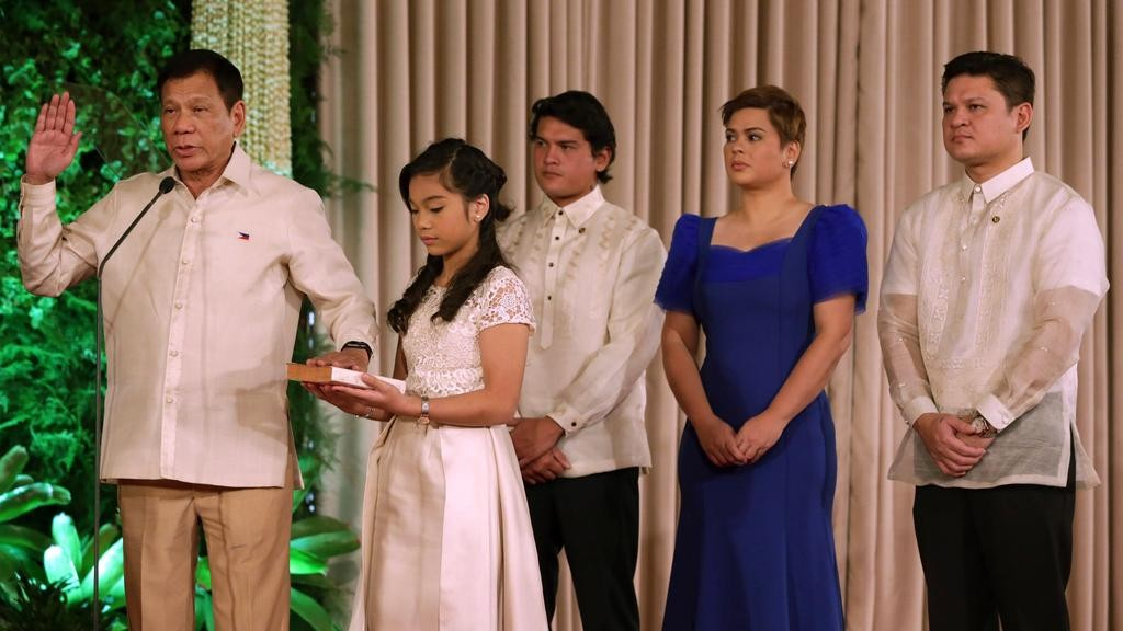 President Duterte (first left) at his 2016 inauguration with Sara Duterte (second from right).