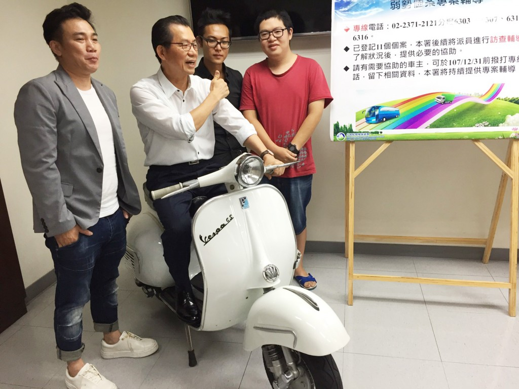 Head of EPA, Lee Ying-yuan sitting on 2-stroke scooter on Aug. 24.