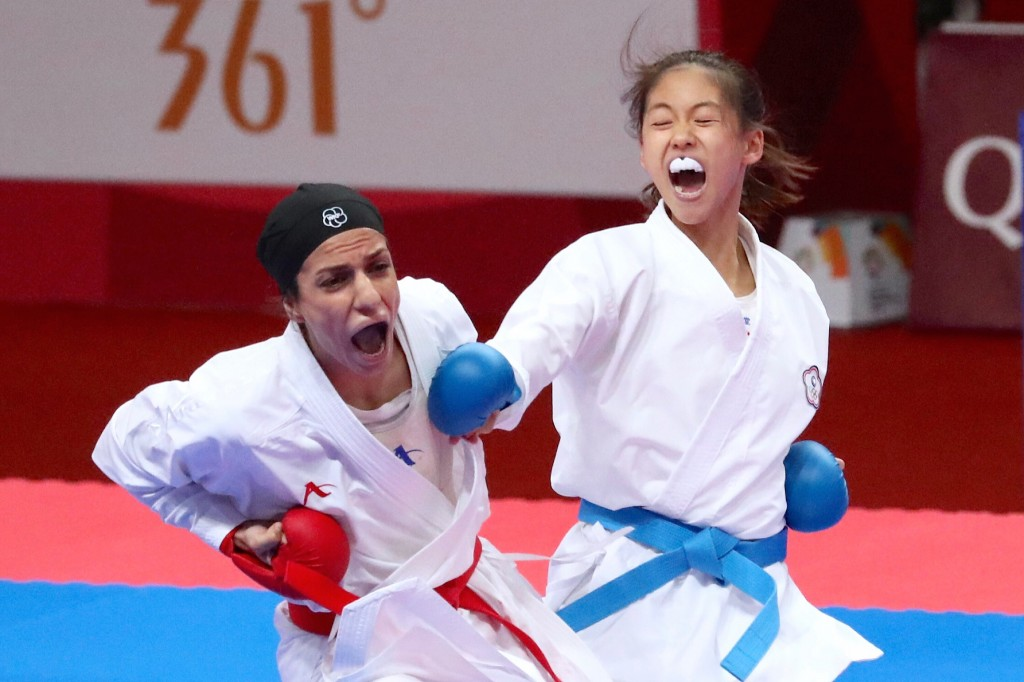Wen Tzu-yun, right, in competition.