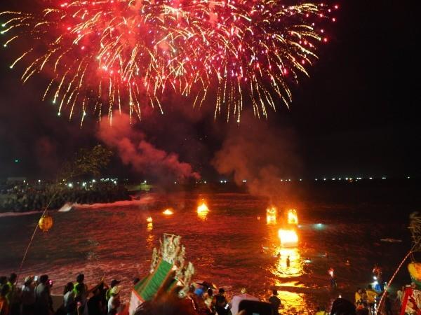 Fireworks over burning paper houses over Badouzi Harbor.