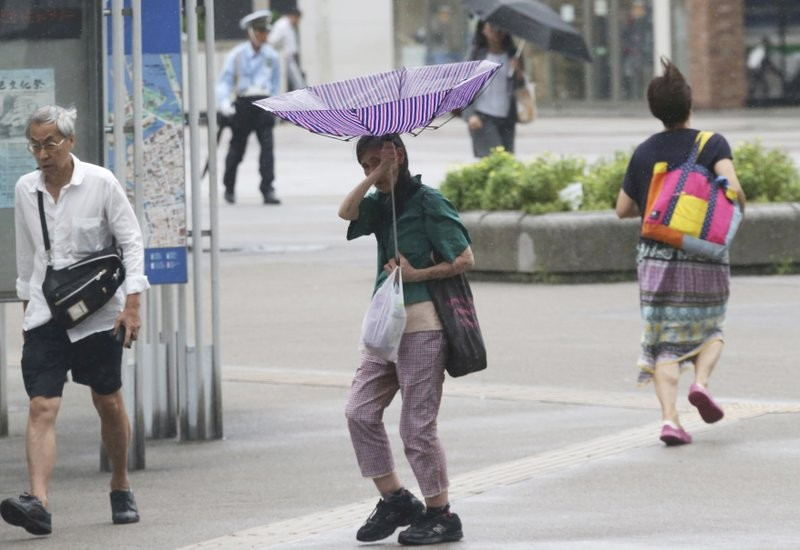 Commuters in Japan protecting themselves against the onslaught of Typhoon Jebi Tuesday.