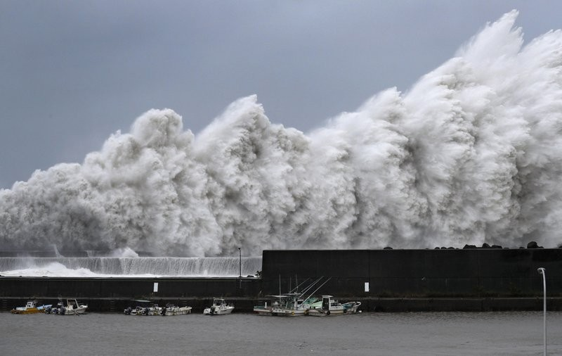 Typhoon Jebi slammed into Japan Tuesday, closing down Osaka's Kansai Airport and causing widespread havoc.
