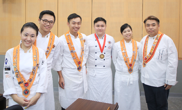 Young chefs from the Ching Kuo Inst. of Mgmt. and Health at a press event for the competition