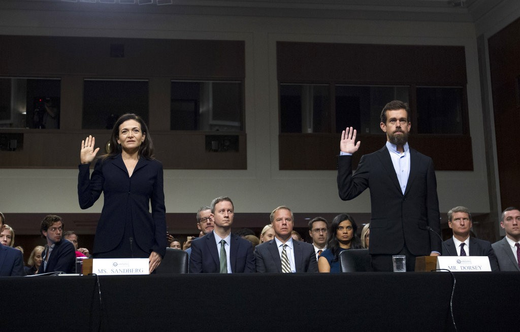 Facebook COO Sheryl Sandberg, left, and Twitter CEO Jack Dorsey are sworn in before the Senate Intelligence Committee hearing, Sept. 5