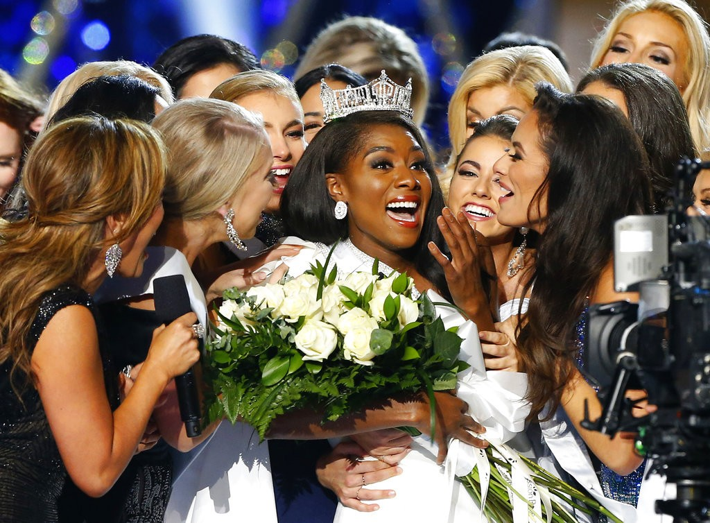 Miss New York Nia Franklin, center, reacts after being named Miss America 2019, Sunday, Sept. 9, 2018, in Atlantic City, N.J. (AP Photo/Noah K. Murray