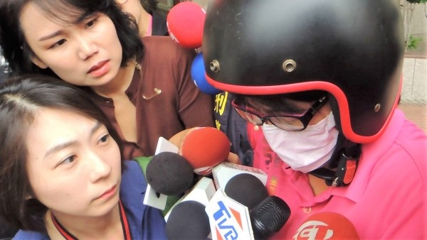 Hung being questioned by reporters.