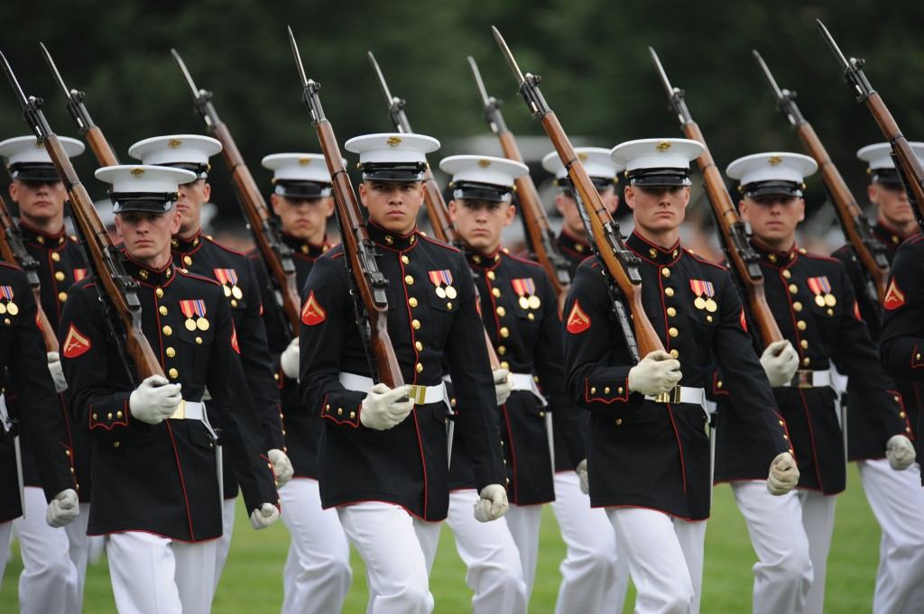 U.S. Marines march past Marine Corps War Memorial in Arlington, Virginia.