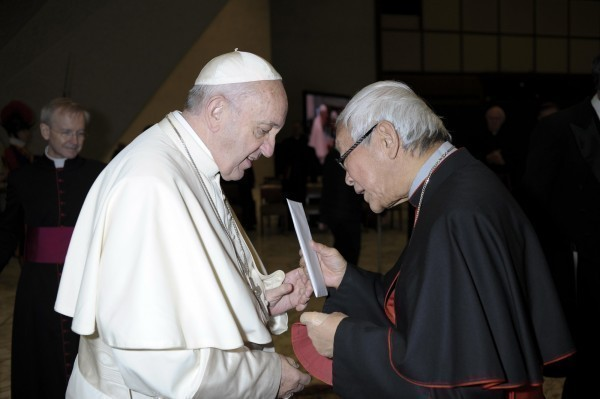 Cardinal Joseph Zen (right) handing a letter to Pope Francis last January.