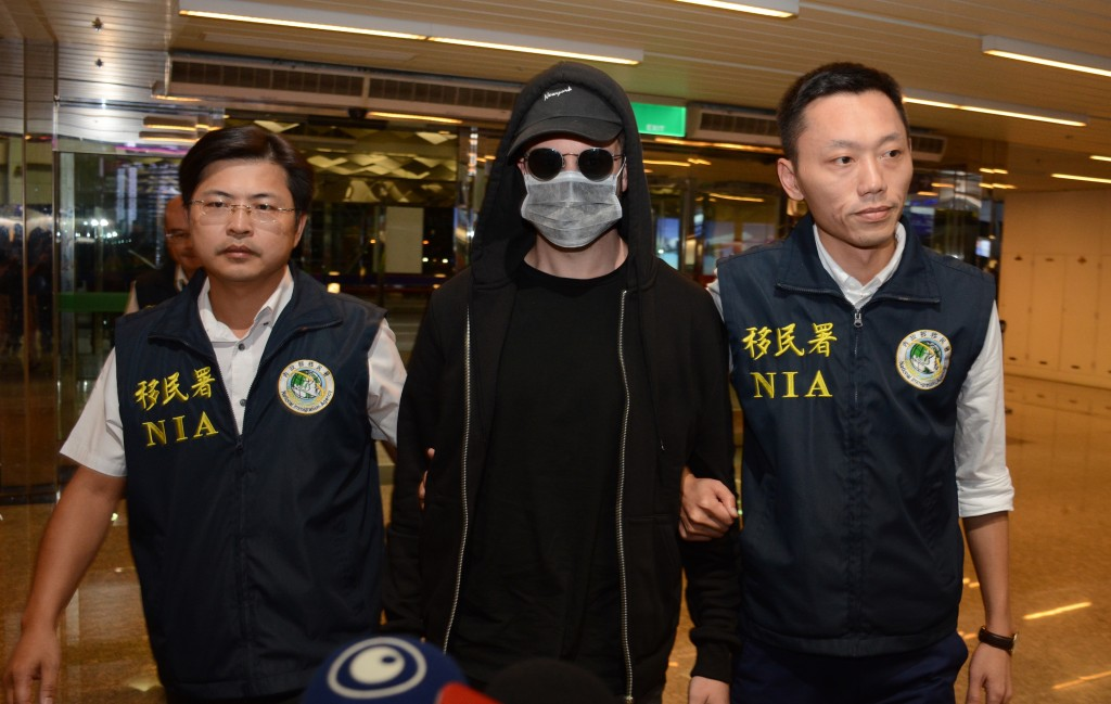 Cody Wilson (center) arriving at Taiwan Taoyuan International Airport for his flight to Houston Saturday evening.