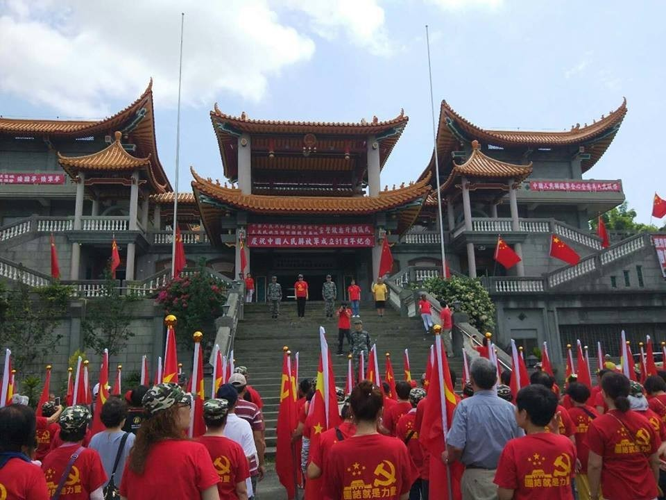 Flag raising ceremony at the communist shrine (Image from Wei Ming-ren's FB page)