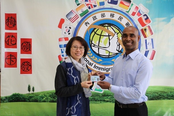 Indian American Terence Rodrigues receives Plum Blossom card. (NIA)
