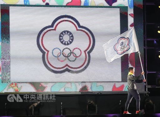 Athlete waves flag at opening ceremony
