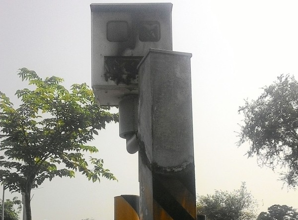 Charred traffic enforcement camera.