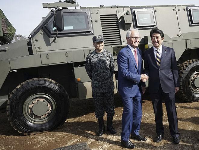Japanese Prime Minister Shinzo Abe (right) meeting Australia's then-Prime Minister, Malcolm Turnbull (center), in Japan last January.