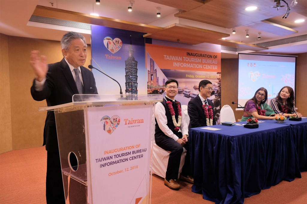 Taiwan's representative in India, Tien Chung-kwang (left), speaking at the opening of the Taiwan Tourism Bureau Information Center in Mumbai Friday.