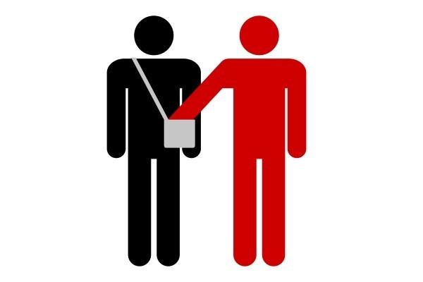 Sign warning of pickpockets.