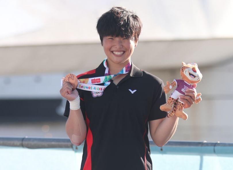 Lai Tzu-hsuan of Taiwan smiles with her bronze medal after placing third in the women's kayaking obstacle slalom event at the Youth Olympic Games Oct.