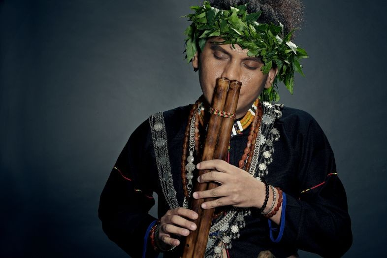 Sangpuy Katatepan Mavaliyw, a singer-songwriter and master of many indigenous instruments, plays a traditional nose flute. (Courtesy of Katatepan Cult
