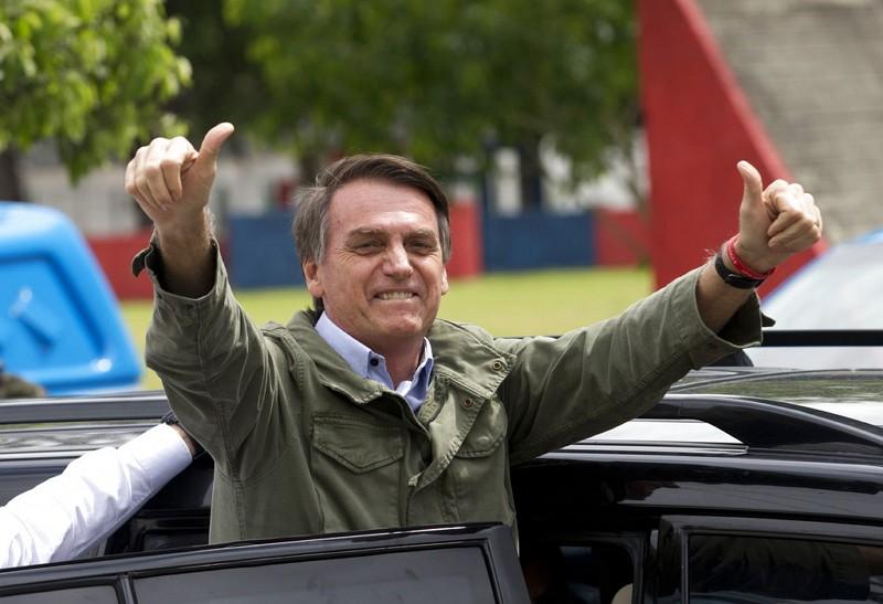 Brazil's Bolsonaro holds double-digit lead over leftist rival