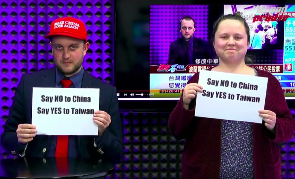 Presenters holding signs saying: Say NO to China, say YES to Taiwan (YouTube screencap)