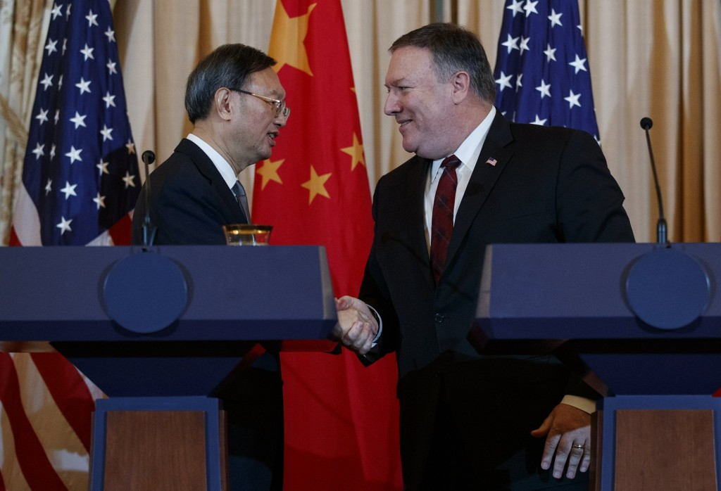 U.S. Secretary of State Mike Pompeo (right) with China State Councilor Yang Jiechi.
