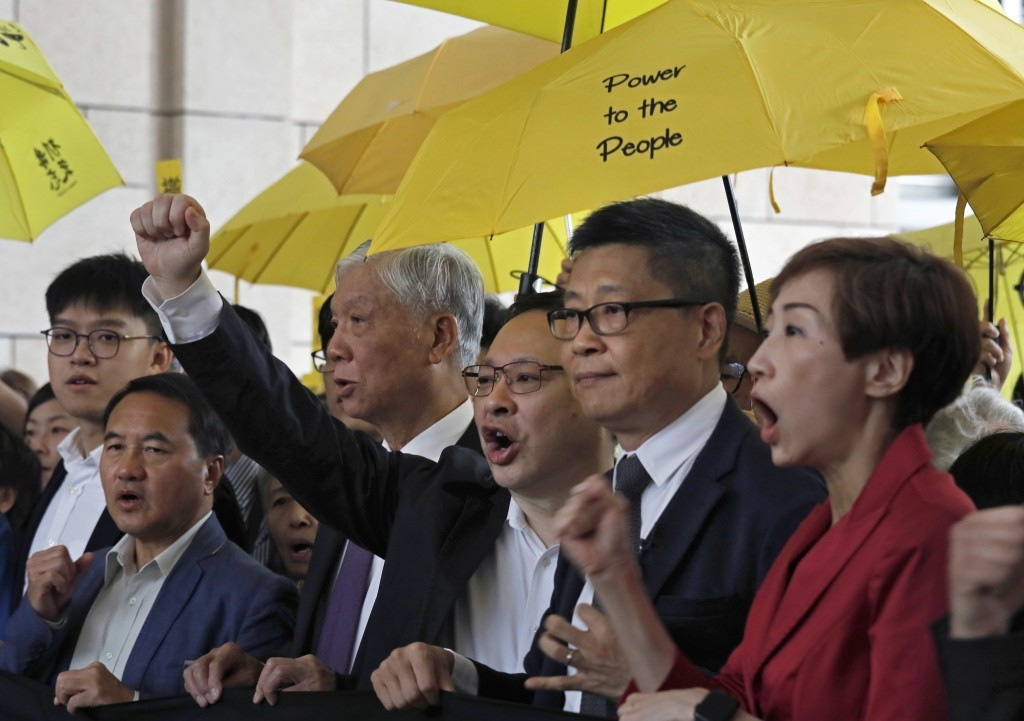 Occupy Central activists address a crowd ahead of their trial