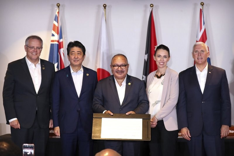 Scott Morrison (far left) met with Papua New Guinean leader Peter O'Neill (center) and Mike Pence (far right) last week.