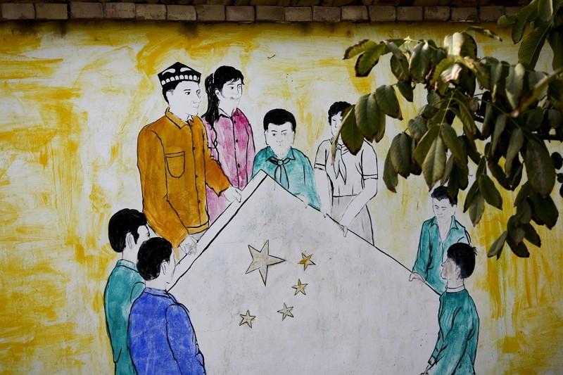 新疆和田市維漢融合壁畫(圖/美聯社)