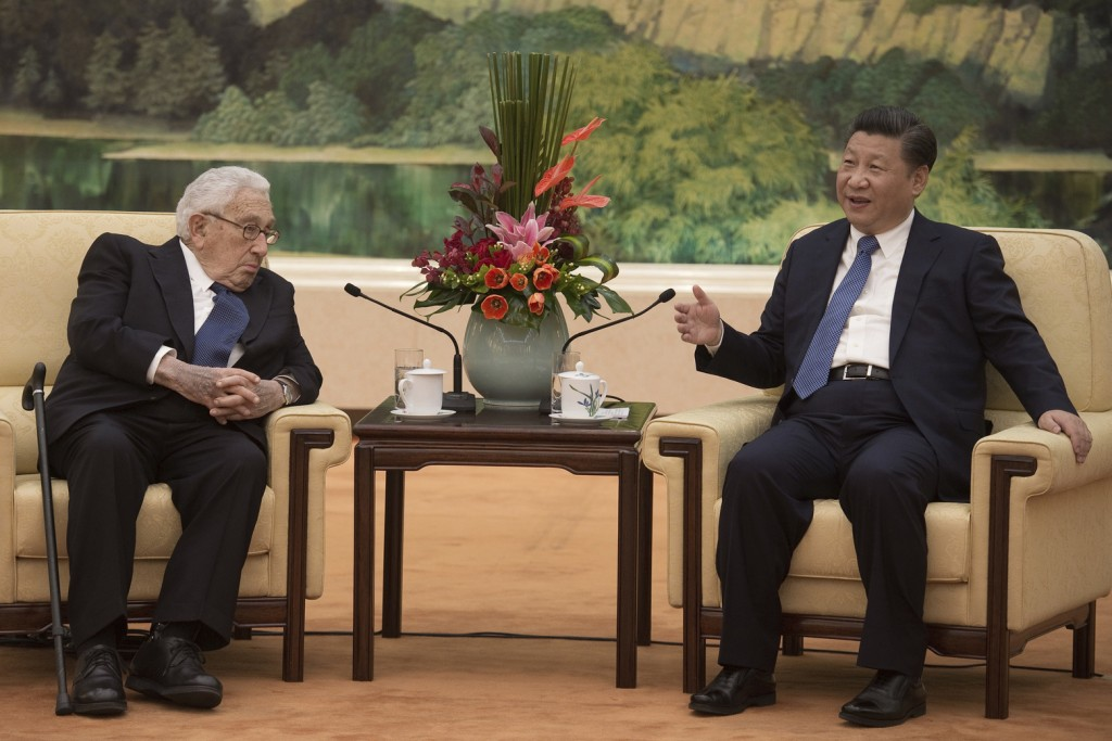 Former US Secretary of State Henry Kissinger, left, meets Xi Jinping at the Great Hall of the People in Beijing on December 2, 2016. (AP)