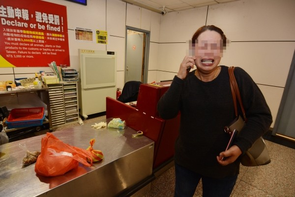 Chinese passenger with seized pork.